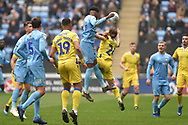 Coventry City defender (on loan from Chelsea) Dujon Sterling (17) handles the ball under pressure from Bristol Rovers midfielder Stuart Sinclair (24) during the EFL Sky Bet League 1 match between Coventry City and Bristol Rovers at the Ricoh Arena, Coventry, England on 7 April 2019.