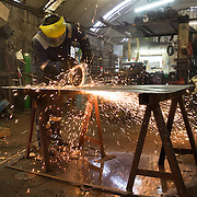 Mallaig Boatyard. Ian MacLeod, fabricator welder  cutting steel . Picture Robert Perry 9th April 2016<br /> <br /> Must credit photo to Robert Perry<br /> FEE PAYABLE FOR REPRO USE<br /> FEE PAYABLE FOR ALL INTERNET USE<br /> www.robertperry.co.uk<br /> NB -This image is not to be distributed without the prior consent of the copyright holder.<br /> in using this image you agree to abide by terms and conditions as stated in this caption.<br /> All monies payable to Robert Perry<br /> <br /> (PLEASE DO NOT REMOVE THIS CAPTION)<br /> This image is intended for Editorial use (e.g. news). Any commercial or promotional use requires additional clearance. <br /> Copyright 2014 All rights protected.<br /> first use only<br /> contact details<br /> Robert Perry     <br /> 07702 631 477<br /> robertperryphotos@gmail.com<br /> no internet usage without prior consent.         <br /> Robert Perry reserves the right to pursue unauthorised use of this image . If you violate my intellectual property you may be liable for  damages, loss of income, and profits you derive from the use of this image.