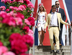 Fashionable racegoers during day five of Royal Ascot at Ascot Racecourse.