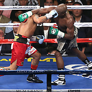 LAS VEGAS, NV - SEPTEMBER 13: (R-L) Floyd Mayweather Jr. loses his tooth after this straight fight hand to the face by Marcos Maidana during their WBC/WBA welterweight title fight at the MGM Grand Garden Arena on September 13, 2014 in Las Vegas, Nevada. (Photo by Alex Menendez/Getty Images) *** Local Caption *** Floyd Mayweather Jr; Marcos Maidana