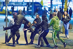 © Licensed to London News Pictures . 07/04/2017 . Manchester , UK . 4th in a sequence . Five youths on one as a fight breaks out in Piccadilly Gardens . Greater Manchester Police have authorised dispersal powers and say they will ban people from the city centre for 48 hours , this evening (7th April 2017) , in order to tackle alcohol and spice abuse . Photo credit : Joel Goodman/LNP
