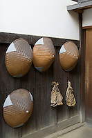 Japanese Monk Hats, usually only worn while collecting alms in the early morning, hang along the wall at Taizoin, a sub temple of Miyoshinji Temple in Kyoto.