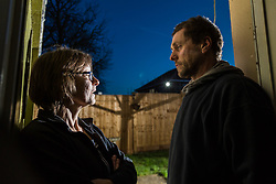 Petra Brittain and partner at home in their cottage where despite appeals to Basildon Council and even their MP they have been unable to prevent a neighbours powerful floodlights on scaffolding surrounding their house from blinding them at night and making it impossible to see in their garden. Wickford, Essex, March 08 2018.