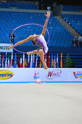 "Averina Dina during hoop routine at the International Tournament of rhythmic gymnastics ""Città di Pesaro"", 10 April, 2015. Dina was born on August 13, 1998 in Zavolzhye, Russia. Dina has a twin sister ,Arina is also herself a great gymnast member of the Russian National Team.<br />