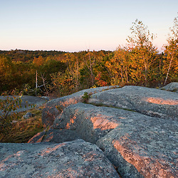 Early morning light on the granite on Sunset Rock in Gloucester, Massachusetts