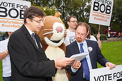 """Nature campaigners accompanied by a  giant red squirrel, Bob, urge MPs to """"Vote For Bob"""" during a photocall outside Parliament. Their aim is to get MPs to support nature in Britain. PICTURED:  Julian Hupert, right, MP receives a petitionfrom Vote for Bob nature campaigners."""