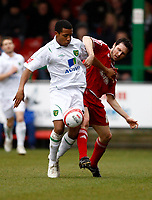 Photo: Richard Lane/Richard Lane Photography. Swindon Town v Norwich City. Coca-Cola Football League One. 20/03/2010. Norwich's Korey Smith challenges Swindon's Alan Sheehan (rt).