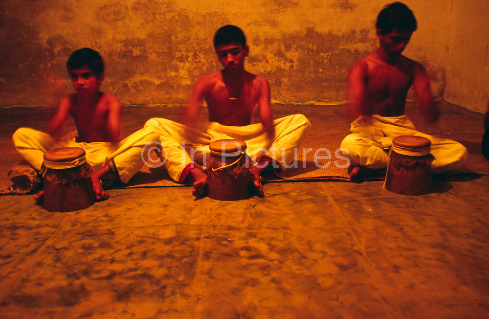 Boys practice their drumming at the Kerala Kalamandalam, Kerala, India<br /> The Kalamandalam was founded in 1930 to preserve the cultural traditions of Kathakali, the stylised dance drama of Kerala. Kathakali is the classical dance-drama of Kerala, South India, which dates from the 17th century and is rooted in Hindu mythology. Kathakali is a unique combination of literature, music, painting, acting and dance performed by actors wearing extensive make up and elaborate costume who perform plays which retell in dance form stories from the Hindu epics.