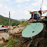 The deck of a house in Lakkhamma Village in Luang Namtha province in northern Laos with a large satellite dish. Lakkhamma Village was established as a joint project between the Lao government and the European Commission.
