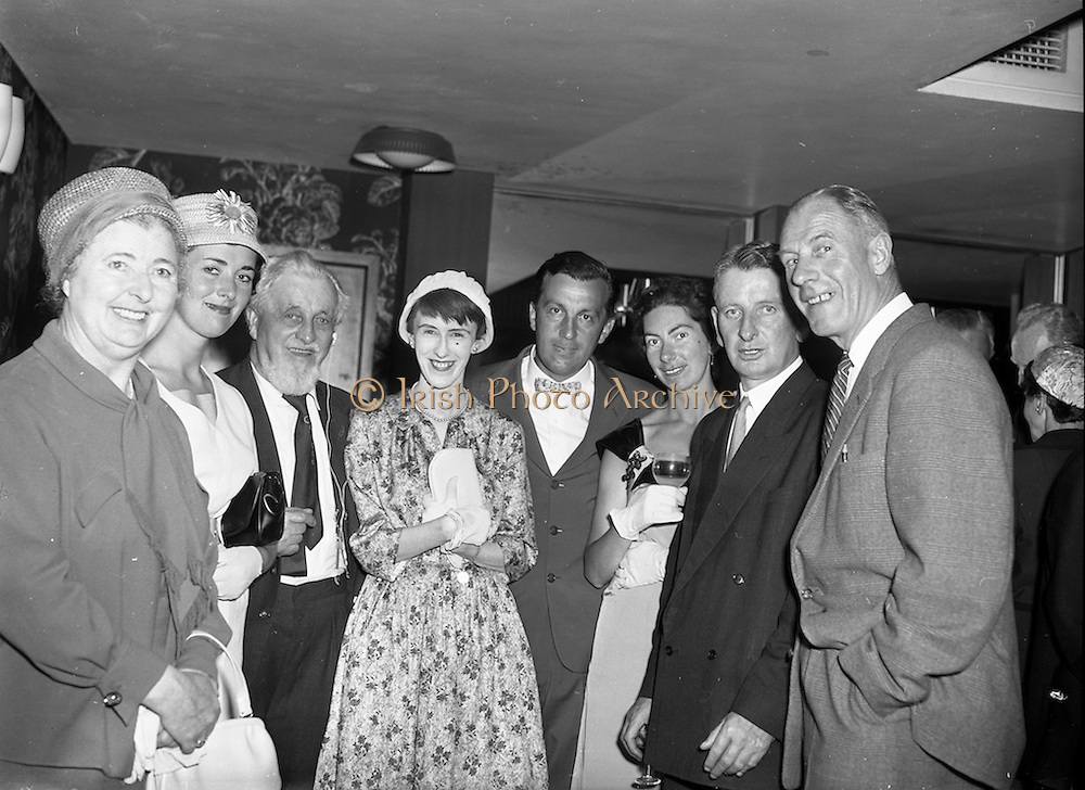 """27/05/1959<br /> 05/27/1959<br /> 27 May 1959<br /> Presentation of Esso Perpetual Trophy to the Listowel Drama Group at the Shelbourne Hotel, Dublin. The trophy and replicas for the  All Ireland Amateur Dram festival were presented by Mr. T.F. Laurie, Chairman and Managing Director of Esso Petroleum Co. (Ireland) Ltd. at a special luncheon. The Listowel group won the competition with their performance of the 3 Act play """"Sive"""" by John B. Keane. Picture shows a group of Kerry people chatting at the reception before the presentation. (l-r) Maire Breathnach; Mrs A.J. (Peg) Schuster (sister of author John B. Keane); Mr. Maurice Walsh, novelist; Siobhan Cahill, (in cast of play); Mr. A.J. Schuster; Mrs Michail Keane (sister-in-law of author); Mr. T. O'Brien, (Listowel) Secretary Department of Lands and Mr. Paul Russell, Chairman of Kerrymans association in Dublin"""