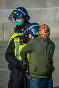 "Police arrest a protestor during a ""Resist and Act for Freedom"" protest against a mandatory coronavirus vaccine, wearing masks, social distancing and a second lockdown, nearby Canada House in Trafalgar Square, London on Saturday, Sept. 19, 2020. The event, which began at noon, drew a broad coalition including coronavirus sceptics, 5G conspiracy theorists and so-called ""anti-vaxxers"". Speakers at the event accused the government of attempting to curtail civil liberties. (VXP Photo/ Erica Dezonne)"