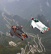 ZHANGJIAJIE, CHINA - OCTOBER 13: (CHINA OUT) <br /> <br /> Swingsuiters Fly Above Tianmen Mountain<br /> <br /> Participants in wingsuit's start to fly above Tianmen Mountain at Zhangjiajie Scenic Spot during a test flying ahead of The 4th Red Bull WWL China Grand Prix on October 13, 2015 in Zhangjiajie, Hunan Province of China. The 4th Red Bull WWL China Grand Prix will be hold on Oct 16-18 in Zhangjiajie. <br /> ©Exclusivepix Media
