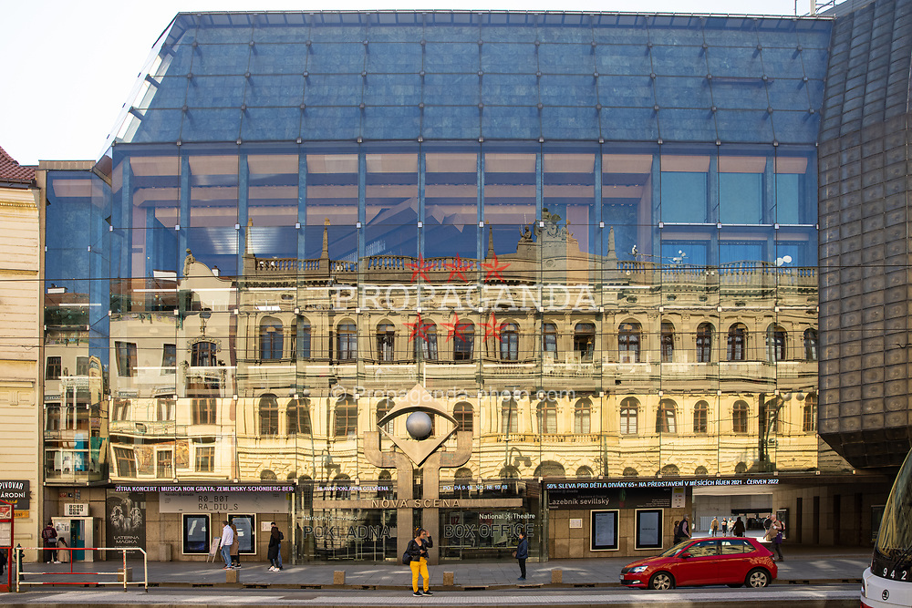PRAGUE, CZECH REPUBLIC - Friday, October 8, 2021: An old building reflected in the glass of a the modern New Stage (Nova Scena). (Pic by David Rawcliffe/Propaganda)