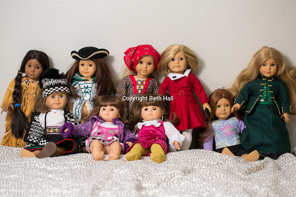 A collection of Amercian Girl dolls in a child's bedroom on March 13, 2015, in Fayetteville, Ark. Photo by Beth Hall