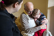The decoration manager who assists the volunteers also makes time to comfort one of the children. Longton Community Church to improve the lives of those in need in their local community, Leyland, Lancashire.