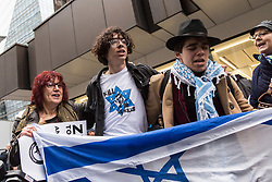 People dance and wave Israeli flags as Jews and supporters from across the UK demonstrate outside the headquarters of the Labour Party in Victoria Street, Westminster, against what they say is ongoing antisemitism within the Labour Party. London, April 08 2018.