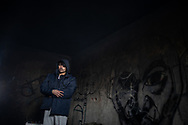 A man from Afghanistan praying. A group of more than 100 migrants are squatting an abandoned building  in the town of Bihac, Bosnia Herzegovina not far from the Croatian border, living without running water electricity and warming them selfs close to smokey bonfire. January 26, 2021. Federico Scoppa