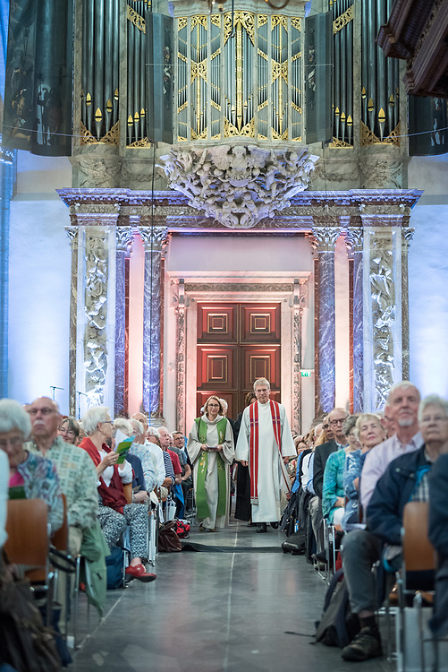 23 August 2018, Amsterdam, Netherlands: Rev. Margarithe Veen and Rev Dr Olav Fykse Tveit enter in procession. Hundreds of people gather from across the world for an ecumenical prayer service at the Nieuwe Kerk, a 15th-century church in Amsterdam, to celebrate the 70th anniversary of the World Council of Churches at the very spot in which the organization was founded. Under the theme ìWalking, Praying and Working Together,î pilgrims from all over the world attend the service.