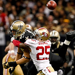 November 25, 2012; New Orleans, LA, USA; San Francisco 49ers cornerback Tarell Brown (25) breaks up a pass to New Orleans Saints tight end Jimmy Graham (80) during the second half of a game at the Mercedes-Benz Superdome. The 49ers defeated the Saints 31-21. Mandatory Credit: Derick E. Hingle-US PRESSWIRE
