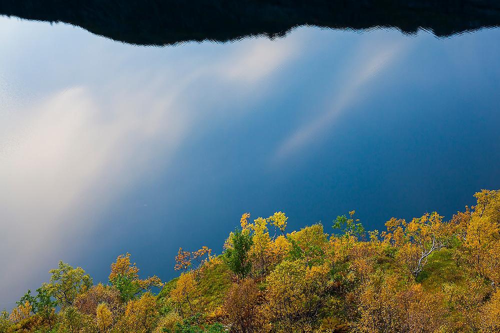 Reflections of the sky in Tridalsvatnet Lake, Moskenesoya, Lofoten Islands, Norway.