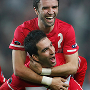 Turkey's Gokhan GONUL (B) celebrates his goal with a teammate during their UEFA EURO 2012 Qualifying round Group A soccer match Turkey between Austria at Sukru Saracoglu stadium in Istanbul March 29, 2011. Photo by TURKPIX
