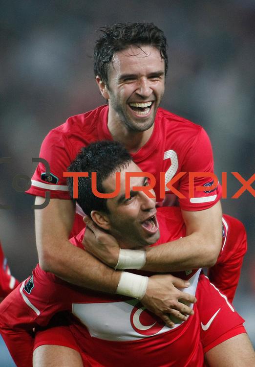 Turkey's Gokhan GONUL (B) celebrates his goal with a teammate during their UEFA EURO 2012 Qualifying round Group A soccer match Turkey between Austria at Sukru Saracoglu stadium in Istanbul March 29, 2011. Photo by TURKPIX
