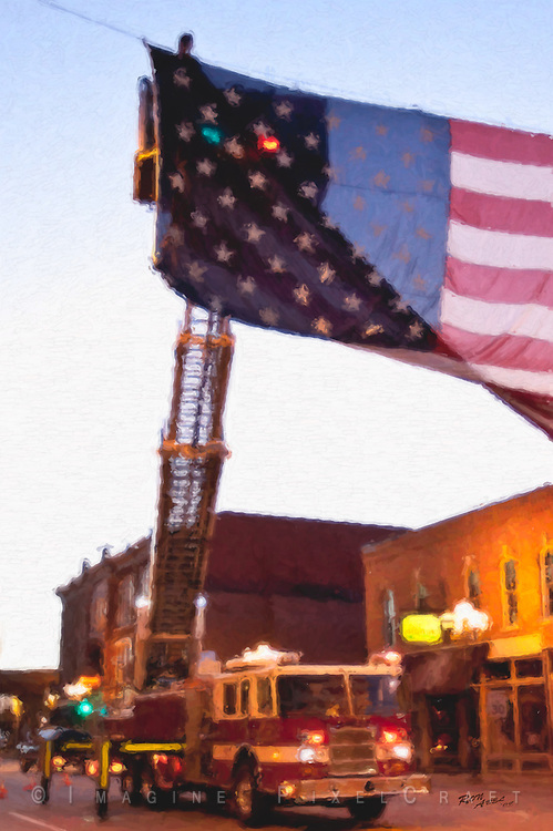 A fire truck ladder squad provdes a lift in hanging the flag before the Quad Cities Marathon 2009