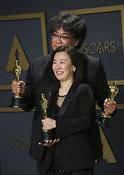 "February 9, 2020, Hollywood, California, USA: Director Bong Joon-ho and producer Kwak Sin-ae, winners of the Original Screenplay, International Feature Film, Directing, and Best Picture awards for ""Parasite,"" pose in the press room of the 92nd Academy Awards on Sunday February 9, 2020 at the Dolby Theater in Hollywood, California. BURT HARRIS/BNS/PI (Credit Image: © Prensa Internacional via ZUMA Wire)"