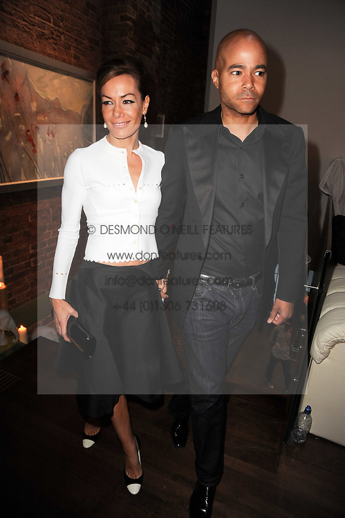 TARA PALMER-TOMKINSON and MARCUS WARREN film producer & director at a private view of Sacha Jafri's paintings entitled 'London to India' held in aid of The Elephant Family charity at 23 Macklin Street, Covent Garden, London on 3rd June 2010.