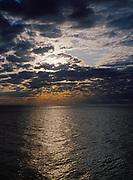 Sun rays streaming through altocumulus clouds above Lake Superior, Split Rock Lighthouse State Park, Minnesota.