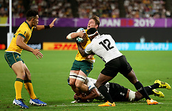 Fiji's Levani Botia (right) tackles Australia's Michael Hooper resulting in a yellow card during the 2019 Rugby World Cup Pool D match at Sapporo Dome.