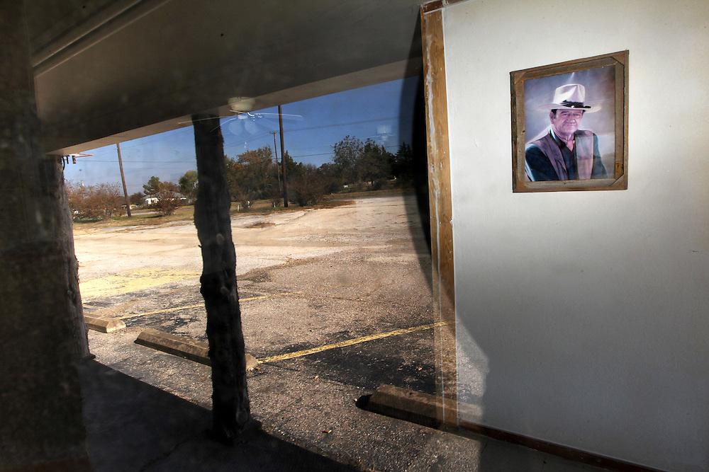 A photo of John Wayne still hangs in the lobby of the vacant Fink Hotel November 18, 2010.