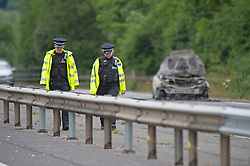 ©Licensed to London News Pictures 16/07/2020     <br /> Tonbridge, UK. A woman has died and a man has been arrested following a car fire on the A21 near Tonbridge in Kent. A police cordon is in place and the A21 is closed. Photo credit: Grant Falvey/LNP
