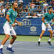 ROBERT FARAH and JUAN SEBASTION CABAL play doubles at the Rock Creek Tennis Center.