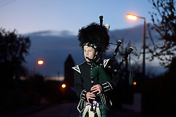 George Orchin (12), a piper in the Campbell College Pipe Band, plays Scotland the Brave outside his neighbour's house in East Belfast, Northern Ireland, during a second Thursday night of 'Clap for our Carers' as people across the country showed their appreciation for all NHS workers who are helping to fight the coronavirus.