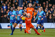 Luton Town midfielder Alan McCormack challenged by Wycombe Wanderers forward Nathan Tyson during the EFL Sky Bet League 1 match between Luton Town and Wycombe Wanderers at Kenilworth Road, Luton, England on 9 February 2019.