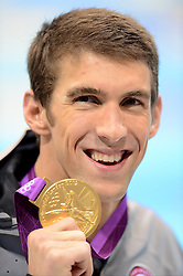 USA's Michael Phelps celebrates with his Gold Medal for winning the Men's 200m Individual Medley at the Aquatics Centre in the Olympic Park, London, on the sixth day of the London 2012 Olympics.