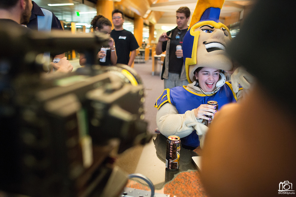Kiara Tomasello, hospitality sophomore and theatre arts minor, reacts after chugging a prop Rockstar energy drink, inside the Sammy Spartan mascot, during the filming of Sammy Spartan Graduates at Dr. Martin Luther King, Jr. Library in San Jose, California, on May 2, 2013. (Stan Olszewski/SOSKIphoto)