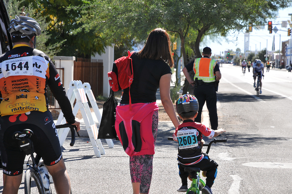 A cycling family reunites after finishing the 2015 Tour de Tucson. Bike-tography by Martha Retallick.