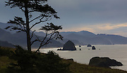 Haystack Rock (big rock in water at middle left) and the beach at Cannon Beach are seen  from Ecola State Park in Cannon Beach, OR.<br /> <br /> Ellen Banner / The Seattle Times