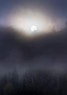 The fog glows as the moon sets over one of the high cliffs in the  Keweenaw Peninsula.