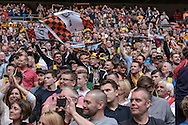 Morpeth Town fans celebrate as their team holds the FA Vase up in front of them after the FA Vase match between Hereford and Morpeth Town at Wembley Stadium, London, England on 22 May 2016. Photo by Mark Doherty.