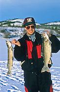 Ice fishing in the Yukon, Canada.