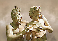 2nd century AD Roman marble sculpture of Pan teaching Daphnis to play the pipes, a Roman copy late 2nd century BC Hellenistic Geek original attributed to Rodes sculptor Heliodoros. Pan's and Daphnis' heads and Daphnis' right arm are restorations.  The Farnese collection, Naples Museum of Archaeology, Italy ..<br /> <br /> If you prefer to buy from our ALAMY STOCK LIBRARY page at https://www.alamy.com/portfolio/paul-williams-funkystock/greco-roman-sculptures.html . Type -    Naples    - into LOWER SEARCH WITHIN GALLERY box - Refine search by adding a subject, place, background colour, museum etc.<br /> <br /> Visit our ROMAN WORLD PHOTO COLLECTIONS for more photos to download or buy as wall art prints https://funkystock.photoshelter.com/gallery-collection/The-Romans-Art-Artefacts-Antiquities-Historic-Sites-Pictures-Images/C0000r2uLJJo9_s0