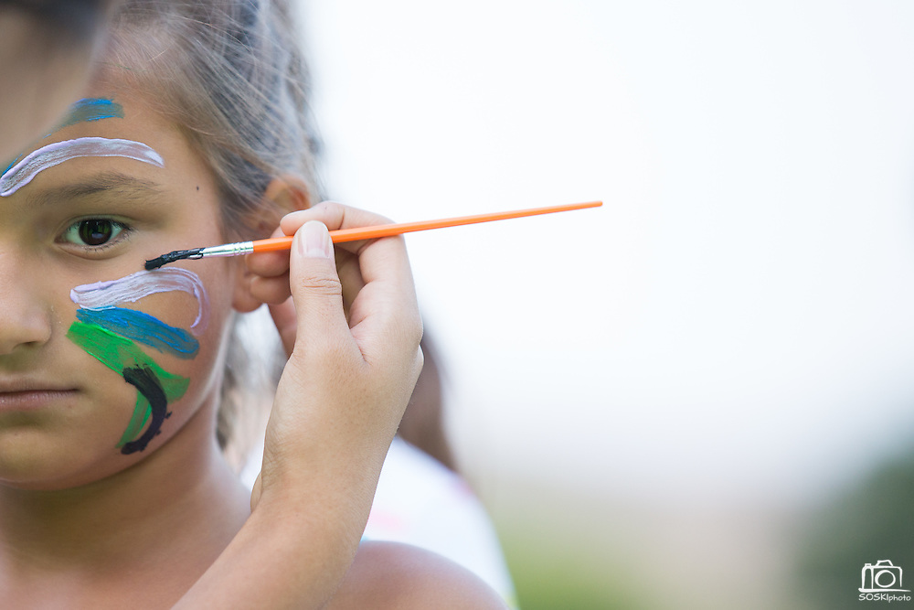 Kids participated in face painting during the National Night Out event at Berryessa Creek Park in San Jose, California, on August 5, 2014. (Stan Olszewski/SOSKIphoto)