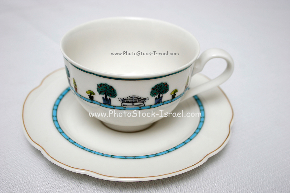Teacup and saucer on white background