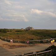 Beach goers head back from Cisco Beach, Nantucket, late in the day. Nantucket Island, Massachusetts, USA. Photo Tim Clayton