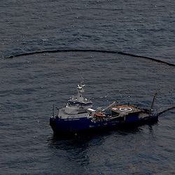 A Coast Guard Responder vessel skims oil at the site of the Deepwater Horizon oil spill in the Gulf of Mexico near the coast of Louisiana, U.S., on Wednesday, June 2, 2010. BP Plc has given up trying to plug its leaking well in the Gulf of Mexico any sooner than August, laying out a series of steps to pipe the oil to the surface and ship it ashore for refining, said Thad Allen, the U.S. government's national commander for the incident. Photographer: Derick E. Hingle