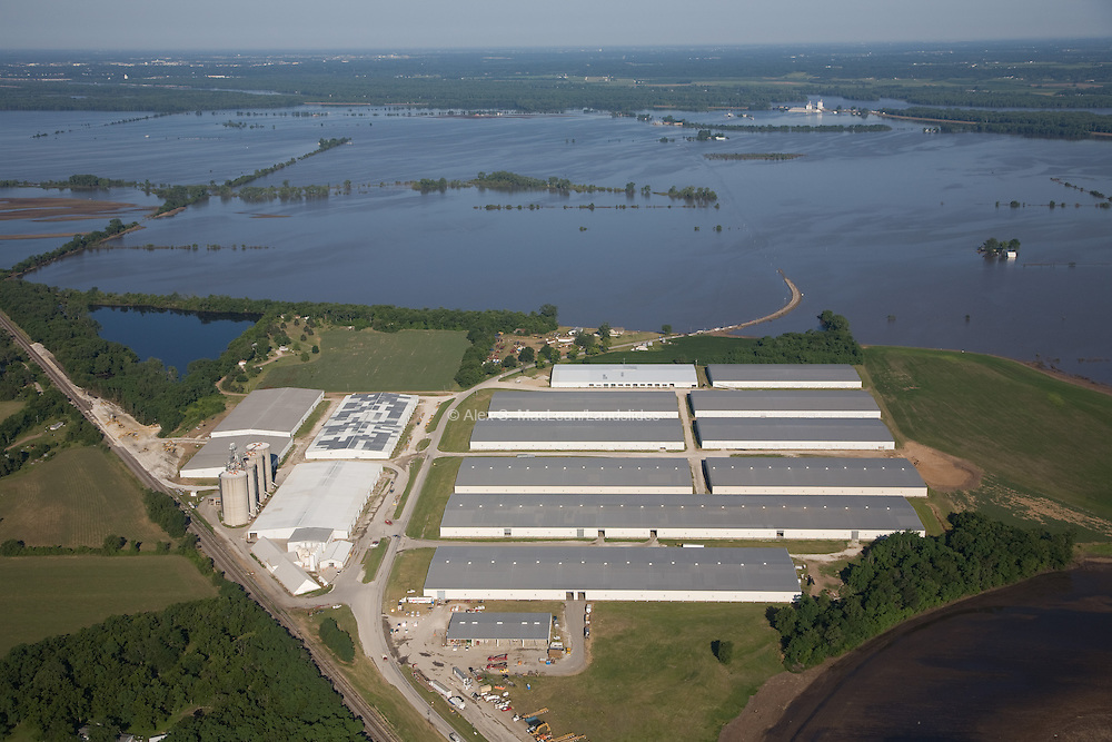 Aerial view of the 2008 Iowa flood along the Mississippi River with large farmland space untouched by the flood.