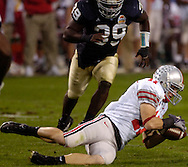 Ohio State tight end Anthony Gonzalez, right, tries to gain control of the ball after it hit the ground last night in the fourth quarter. Notre Dame recovered the fumble and returned it for a touchdown, but a penalty called the play back. After a instant replay review, officials ruled Gonzalez never had possession of the ball.